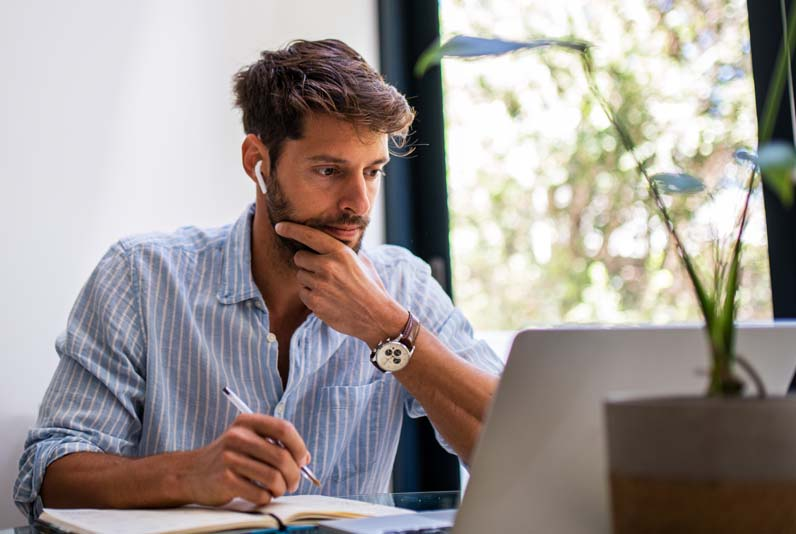 Image of a man working at a computer